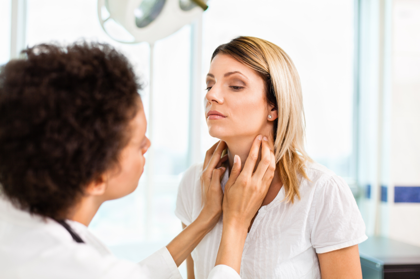 Doctor checking out patient's thyroid as she thinks of questions